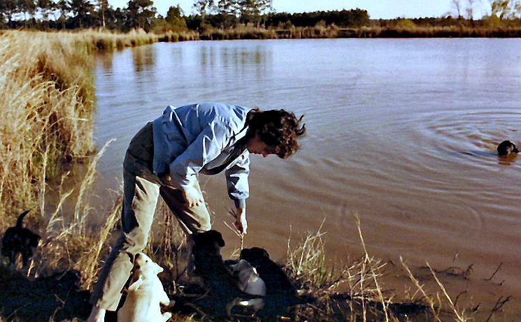 Beth with Amanda Blackvelvet's pups at pond on William's Ditch Road (where we lived from 1986-1996)