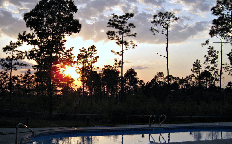"""Sunset over the """"cement pond"""" at Longleaf Preserve."""